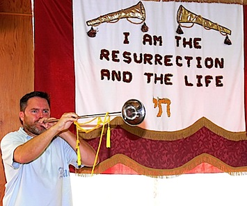 Joshua blows a trumpet on Yom Teruah