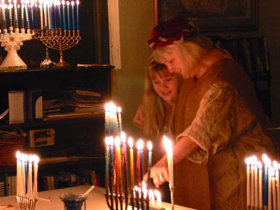 Ellie shows Natalie the lights of Chanukah